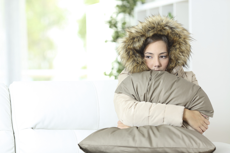 woman freezing cold at home